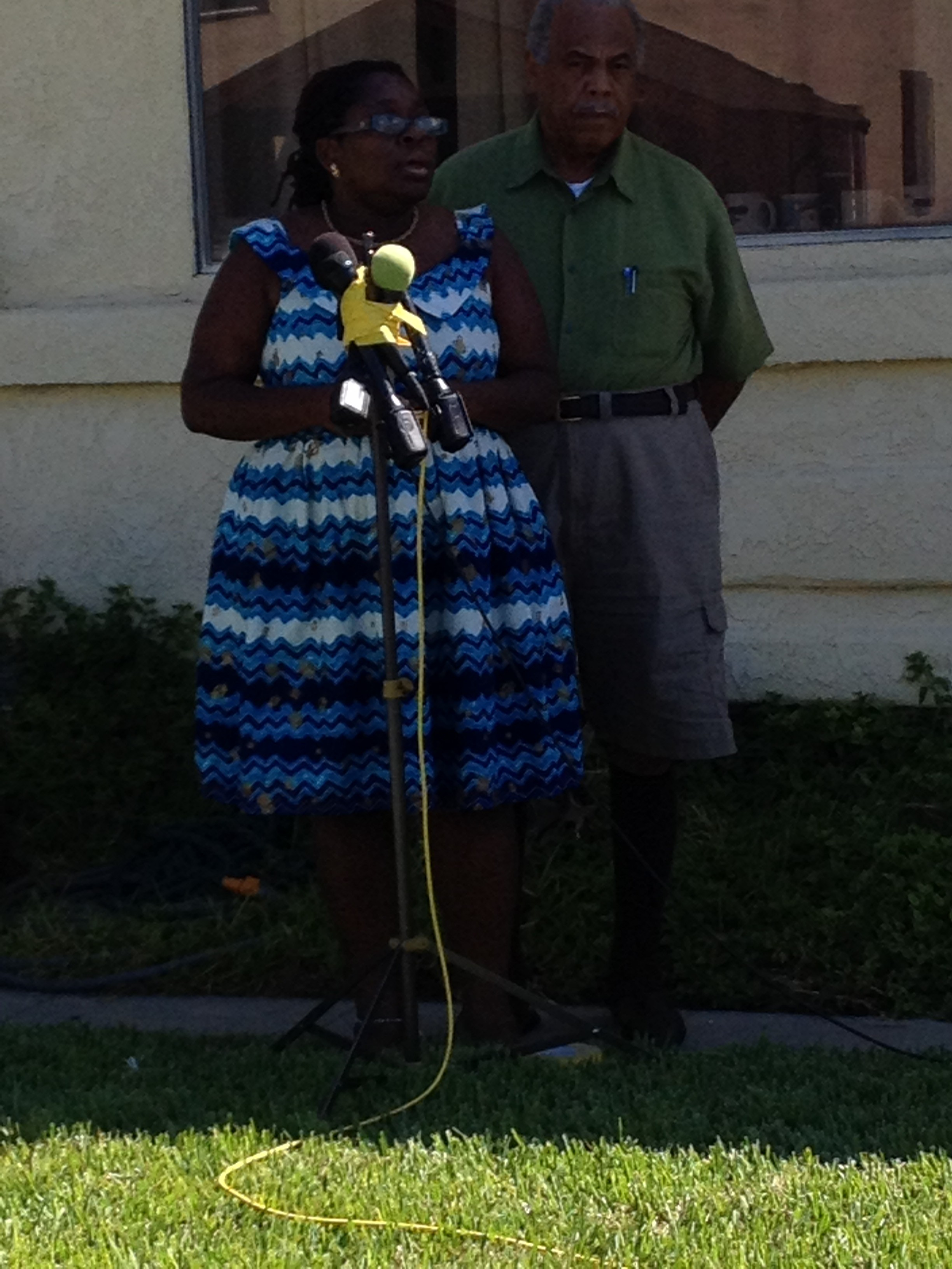 Attorney Nana Gyamfi stands with South LA homeowner Warren Johnson Fri. Aug. 29 at a press conference discussing the LAPD's trashing of his home.