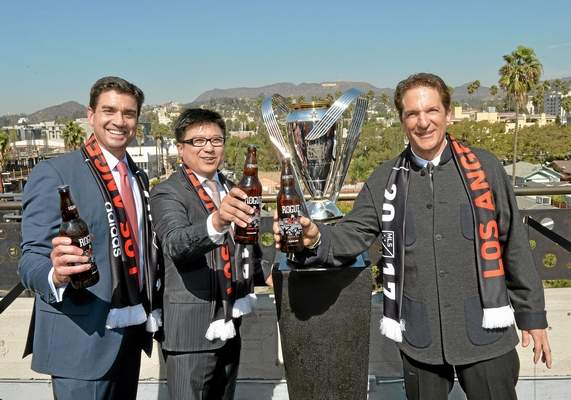 Los Angeles Football Club co-owners Tom Penn, from left, Henry Nguyen and Peter Guber, seen at the press conference to announce the new Los Angeles MLS team and ownership group in October in Hollywood, might not have such an easy time finding a site for a stadium in Southern California. (Charley Gallay/Getty Images for LAFC)