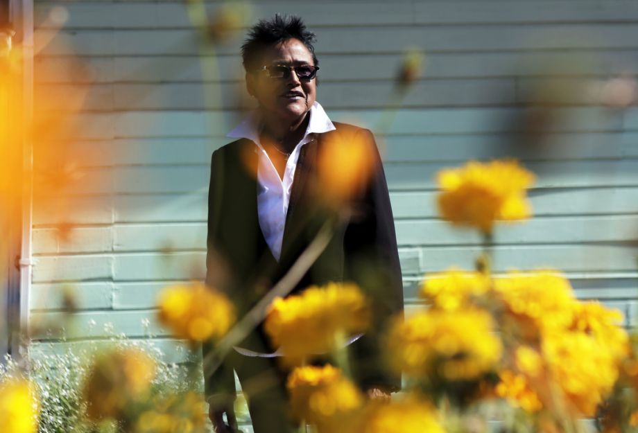 Photo: Dorothy Edwards / Dorothy Edwards / The Chronicle Left: Elaine Brown, for mer Black Panther lead er and now CEO of the nonprofit Oakland and the World Enterprises, amid the plantings.