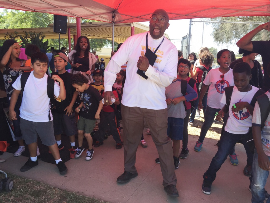 "State-appointed administrator Vincent Matthews dances the ""Cupid Shuffle"" with students at a back-to-school event August 19, 2016. PRISKA NEELY/KPCC"