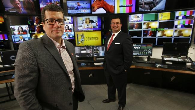 Otto Padron, left, President/COO of Meruelo Media Holdings LLC., and Xavier Gutierrez, President/Chief Investment Officer of Meruelo Group, are photographed inside the master control room at Meruelo Media Broadcast & Studio Center in Los Angeles. (Mel Melcon / Los Angeles Times)