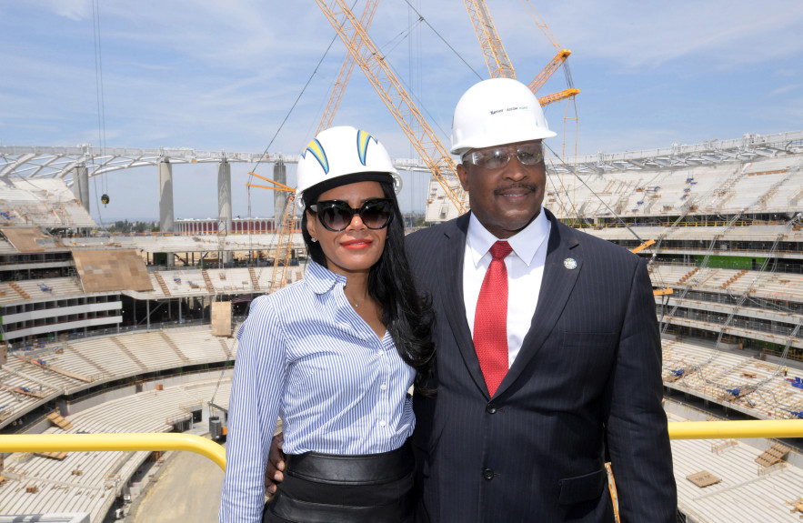 Apr 15, 2019; Inglewood, CA, USA; Inglewood mayor James Butts aka James T. Butts (right) and Melanie McDade-Dickens pose at the LA Stadium & Entertainment District construction site. The site will be the home of the Los Angeles Chargers and the Los Angeles Rams plus Super Bowl LVI in 2022 and the College Football National Championship in 2023 and the opening and closing ceremonies of the 2028 Olympic Games. (Photo by Kirby Lee, USA TODAY Sports via Reuters)