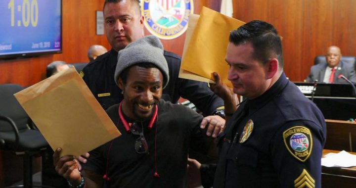 Uplift Inglewood coalition member Michael Wilson being physically removed from the speakers podium at the regular Inglewood City Council meeting held June 19, 2018, after trying to serve the Mayor and Council with a new lawsuit. (photo: D'artagnan Scorza)