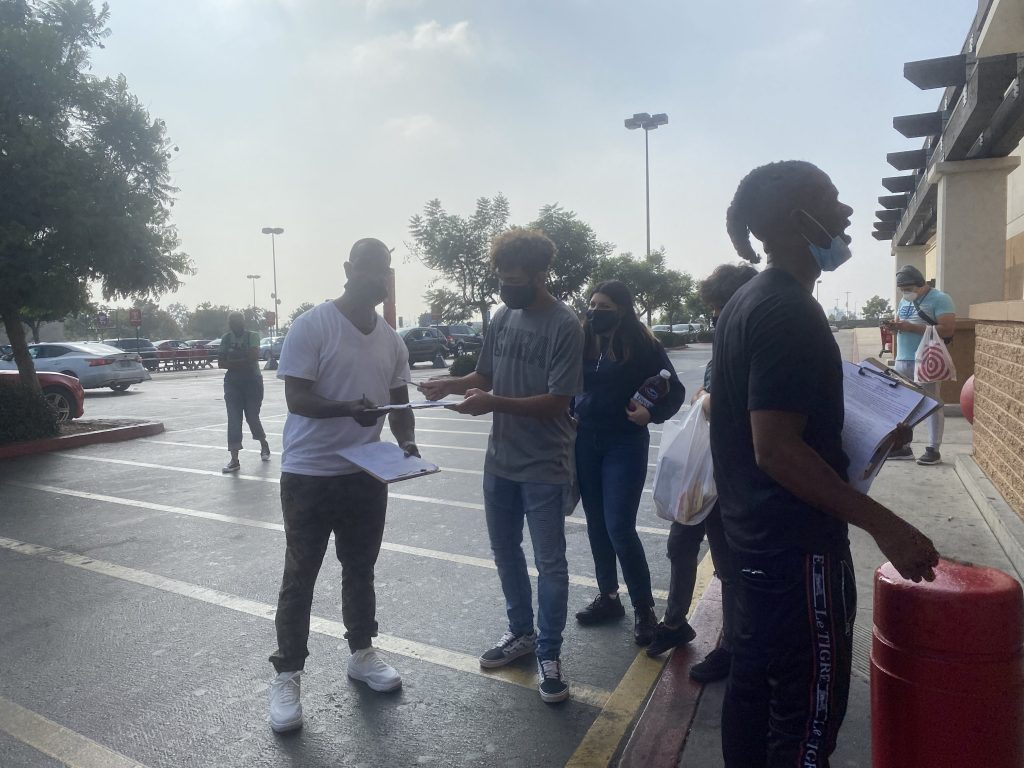 Inglewood residents signing referendum petition outside local Target (photo: 2UrbanGirls)